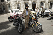 Indian-born American designer and actor Waris Ahluwalia poses with motorbikes as the Duchess of Cornwall, Joint President, Elephant Family, officially launches the Concours d'elephant, a cavalcade of traditional Indian vehicles which will tour London to raise awareness of the charity's work to protect the Asian elephant at the Oriental Club on June 21, 2018 in London, England. The Elephant Family is an international NGO dedicated to protecting the Asian elephant from extinction in the wild.