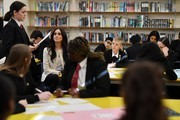 Meghan, Duchess of Sussex  listens to a student reciting a poem as she visits the Robert Clack Upper School in Dagenham to attend a special assembly ahead of International Women's Day (IWD) held on Sunday 8th March, on March 6, 2020 in London, England.