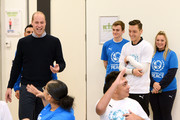 Prince William, Duke of Cambridge (L) and Mesut Ozil (2ndR) attends the graduation ceremony of 30 Young Peace Leaders from Football for Peace's UK City for Peace programme at Copper Box Arena on November 22, 2018 in London, England.