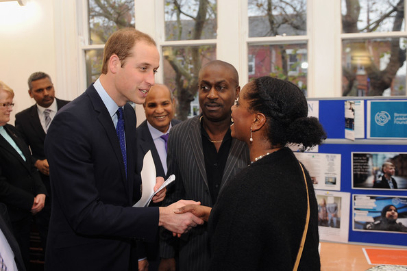 Prince William, Duke of Cambridge meets Ricky Dehaney (C) and Andrea Sterling from Prisonlink during his visit to South and City College on November 29, 2013 in Birmingham, England.