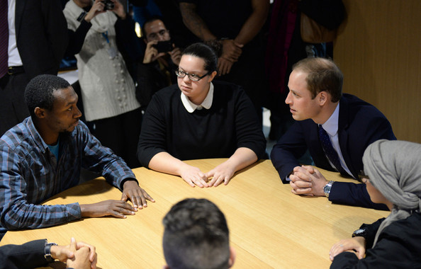 Prince William, Duke of Cambridge meets libray users as he visits Birmingham Library on November 29, 2013 in Birmingham, England.