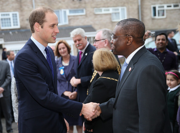 Prince William, Duke of Cambridge greets Chief Executive of Centrepoint Seyi Obakin as he arrives  at St Basil's Charity project on November 29, 2013 in Birmingham, England. St Basil's is a Youth Homeless charity supported by Centrepoint, the homeless charity of which Prince William is Patron.