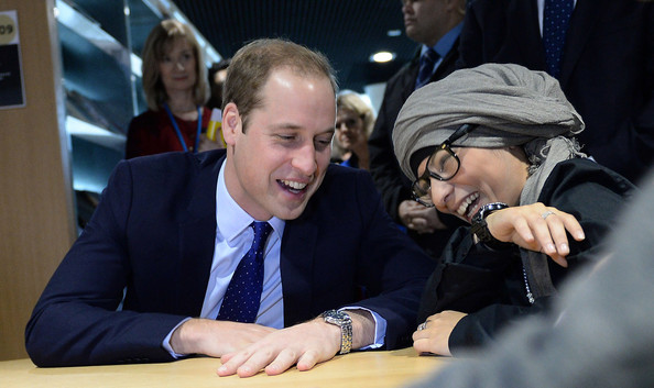 Prince William, Duke of Cambridge meets a young library user as he visits Birmingham Library on November 29, 2013 in Birmingham, England.