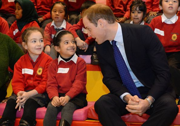 Prince William, Duke of Cambridge talks to young children from Chandos Primary School during story time as he visits Birmingham Library on November 29, 2013 in Birmingham, England.