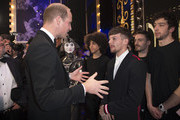 Prince William, Duke of Cambridge speaks to Louis Tomlinson and performers on stage as they attend the Royal Variety Performance at the Palladium Theatre on November November 24, 2017 in London, England. The Royal Variety Performance takes place every year, either in London or in a theatre around the United Kingdom. The event is in aid of the Royal Variety Charity, formally, The Entertainment Artistes Benevolent Fund, of which The Queen is Patron. The money raised from the show helps hundreds of entertainers throughout the UK, who need help and assistance as a result of old age, ill-health, or hard times.