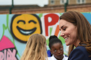 Catherine, Duchess of Cambridge is presented with a gift for Prince George during a visit to The Way Youth Zone on May 13, 2021 in Wolverhampton, England.