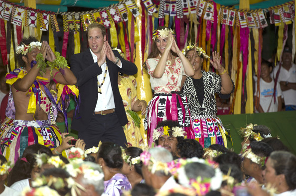 Prince William, Duke of Cambridge and Catherine, Duchess of Cambridge dance with the ladies at the Vaiku Falekaupule for an entertainment programme on September 18, 2012 in Tuvalu. Prince William, Duke of Cambridge and Catherine, Duchess of Cambridge are on a Diamond Jubilee tour representing the Queen taking in Singapore, Malaysia, the Solomon Islands and Tuvalu.