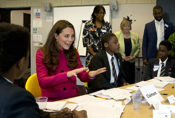 Catherine, Duchess of Cambridge talks to young students who are taking part in a role playing lesson about the workings of a British court at Stephen Lawrence Centre in Deptford on March 27, 2015 in London, England. The centre is built in memory of 19 years old Stephen Lawrence, who was stabbed to death by a group of white youths in April 1993 as he was waiting for a bus.