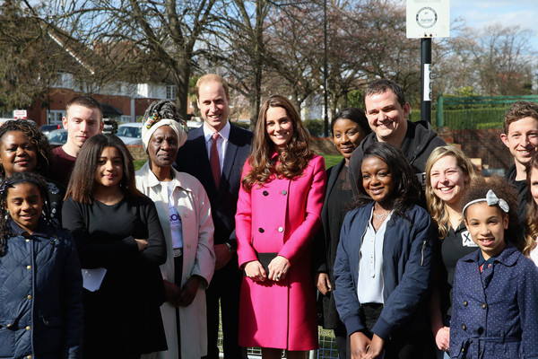 Prince William, Duke of Cambridge and Catherine, Duchess of Cambridge pose for a group photograph at the XLP Mobile recording Studio on March 27, 2015 in London, England.