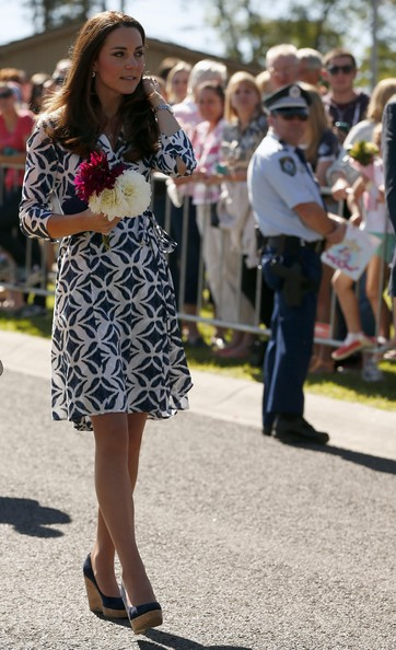 Catherine, Duchess of Cambridge waves to the public at the Blue Mountains suburb of Winmalee that lost homes during bushfires last year, on April 17, 2014 in Katoomba, Australia. The Duke and Duchess of Cambridge are on a three-week tour of Australia and New Zealand, the first official trip overseas with their son, Prince George of Cambridge.