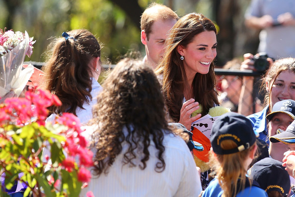 Catherine, Duchess of Cambridge speaks with Girl Guides after planting a tree at the Winmalee Guide Hall on April 17, 2014 in Winmalee, Australia. The Duke and Duchess of Cambridge are on a three-week tour of Australia and New Zealand, the first official trip overseas with their son, Prince George of Cambridge.