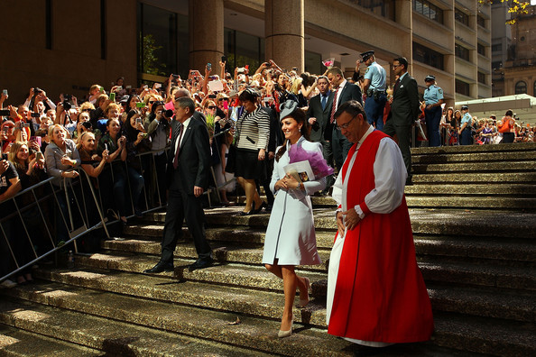 Catherine, Duchess of Cambridge is escorted past awaiting fans following Easter Sunday Service at St Andrews Cathedral on April 20, 2014 in Sydney, Australia. The Duke and Duchess of Cambridge are on a three-week tour of Australia and New Zealand, the first official trip overseas with their son, Prince George of Cambridge.