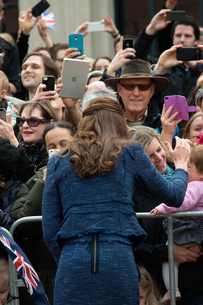 Catherine, Duchess of Cambridge speaks to members of the public during a walk about in Civic Square on April 16, 2014 in Wellington, New Zealand. The Duke and Duchess of Cambridge are on a three-week tour of Australia and New Zealand, the first official trip overseas with their son, Prince George of Cambridge.