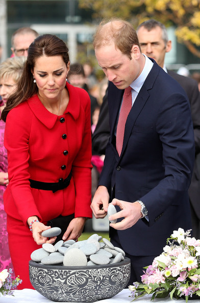 Prince William, Duke of Cambridge and Catherine, Duchess of Cambridge lay a stone during a visit the CTV memorial site on April 14, 2014 in Christchurch, New Zealand. The Duke and Duchess of Cambridge are on a three-week tour of Australia and New Zealand, the first official trip overseas with their son, Prince George of Cambridge.