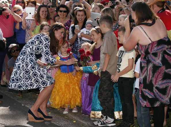 Catherine, Duchess of Cambridge receives a flower from a girl as she meets locals as she tours the Blue Mountains suburb of Winmalee with her husband Prince William, Duke of Cambridge on April 17, 2014 in Katoomba, Australia. The Duke and Duchess of Cambridge are on a three-week tour of Australia and New Zealand, the first official trip overseas with their son, Prince George of Cambridge.