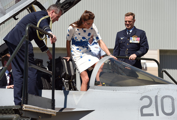 Flanked by Chief of Air Force, Air Marshall Geoff Brown (R), and Commanding Officer of Number 1 Squadron , Wing Commander Stephen Chappell (R), Catherine, the Duchess of Cambridge (C), makes her way into the cockpit of a RAAF Super Hornet of 1 Squadron at the Royal Australian Airforce Base at Amberley on April 19, 2014 in Brisbane, Australia. The Duke and Duchess of Cambridge are on a three-week tour of Australia and New Zealand, the first official trip overseas with their son, Prince George of Cambridge.