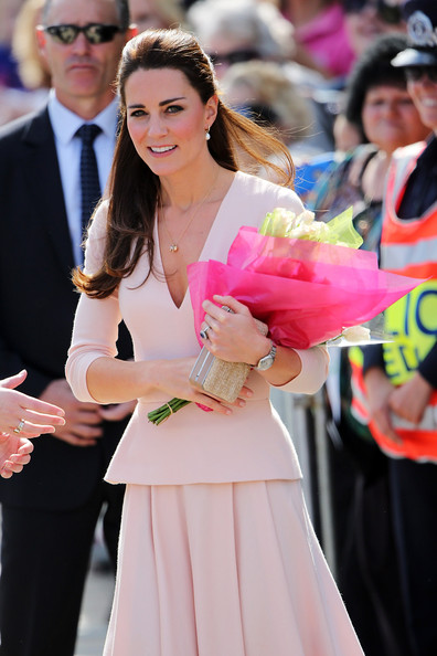 Catherine, Duchess of Cambridge  receives flowers from spectators at the Playford Civic Centre on April 23, 2014 in Adelaide, Australia. The Duke and Duchess of Cambridge are on a three-week tour of Australia and New Zealand, the first official trip overseas with their son, Prince George of Cambridge.