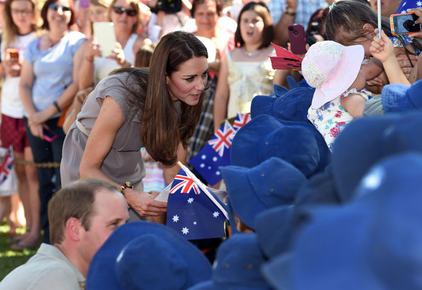 Catherine, Duchess of Cambridge and Prince William, Duke of Cambridge talk to school children during a visit to the National Indigenous Training Academy at Yulara on April 22, 2014 in Ayers Rock, Australia. The Duke and Duchess of Cambridge are on a three-week tour of Australia and New Zealand, the first official trip overseas with their son, Prince George of Cambridge.