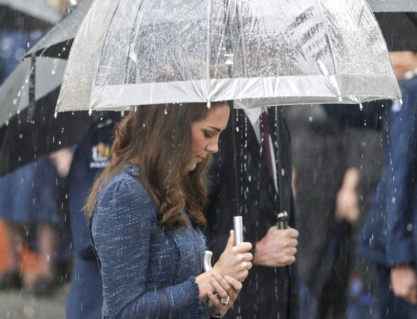 Catherine, Duchess of Cambridge stands at the Remembrance Wall during a visit to the Royal New Zealand Police College on April 16, 2014 in Wellington, New Zealand. The Duke and Duchess of Cambridge are on a three-week tour of Australia and New Zealand, the first official trip overseas with their son, Prince George of Cambridge.