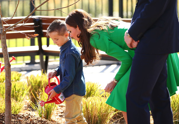Catherine, Duchess of Cambridge and Prince William, Duke of Cambridge watch talks to a child as he helps them with a tree planting as they visit the National Arboretum on April 24, 2014 in Canberra, Australia. The Duke and Duchess of Cambridge are on a three-week tour of Australia and New Zealand, the first official trip overseas with their son, Prince George of Cambridge.