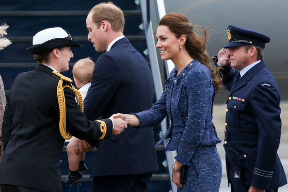Catherine, Duchess of Cambridge, Prince William, Duke of Cambridge and Prince George of Cambridge are farewelled before boarding a Royal Australian Air Force plane for their flight to Australia at Wellington Airport's military terminal April 16, 2014 in Wellington, New Zealand. The Duke and Duchess of Cambridge are on a three-week tour of Australia and New Zealand, the first official trip overseas with their son, Prince George of Cambridge.