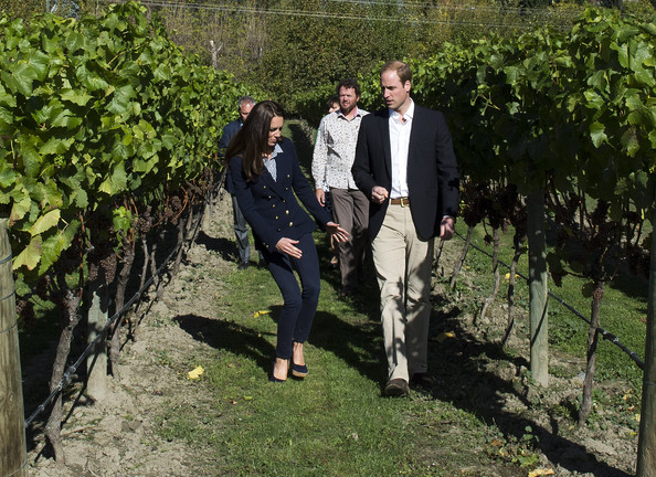 Catherine, Duchess of Cambridge stumbles as she walks through the vineyard with Prince William, Duke of Cambridge visit the Amisfield Winery on April 13, 2014 in Queenstown, New Zealand. The Duke and Duchess of Cambridge are on a three-week tour of Australia and New Zealand, the first official trip overseas with their son, Prince George of Cambridge.