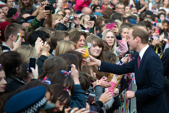 Prince William, Duke of Cambridge receives gifts and shakes hands with the public during a walk about in Civic Square on April 16, 2014 in Wellington, New Zealand. The Duke and Duchess of Cambridge are on a three-week tour of Australia and New Zealand, the first official trip overseas with their son, Prince George of Cambridge.