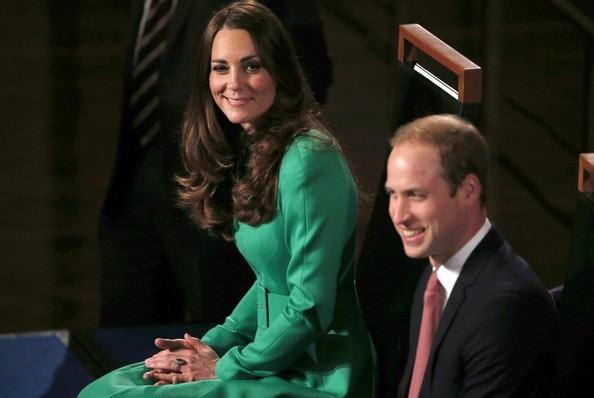 Catherine, the Duchess of Cambridge smiles as she sits next to her husband Prince William, Duke of Cambridge during a reception in the Great Hall at Parliament House on April 24, 2014 in Canberra, Australia. The Duke and Duchess of Cambridge are on a three-week tour of Australia and New Zealand, the first official trip overseas with their son, Prince George of Cambridge.