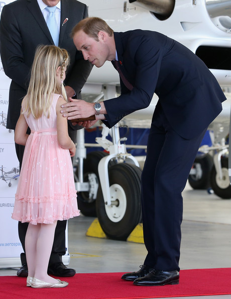 Prince William, Duke of Cambridge is presented with a gift as he visits Pacific Aerospace on April 12, 2014 in Hamilton, New Zealand. The Duke and Duchess of Cambridge are on a three-week tour of Australia and New Zealand, the first official trip overseas with their son, Prince George of Cambridge.