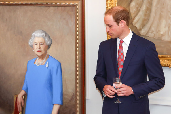 Prince William, Duke of Cambridge stands next to a painting of Queen Elizabeth II unveiled during a state reception at Government House on April 10, 2014 in Wellington, New Zealand. The Duke and Duchess of Cambridge are on a three-week tour of Australia and New Zealand, the first official trip overseas with their son, Prince George of Cambridge.