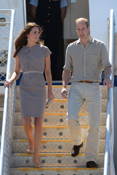 Catherine, Duchess of Cambridge and Prince William, Duke of Cambridge arrive at Ayres Rock Airport on April 22, 2014 in Ayers Rock, Australia. The Duke and Duchess of Cambridge are on a three-week tour of Australia and New Zealand, the first official trip overseas with their son, Prince George of Cambridge.