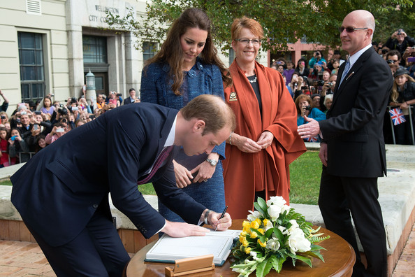 Prince William, Duke of Cambridge signs the Visitor's Book during a walk about in Civic Square on April 16, 2014 in Wellington, New Zealand. The Duke and Duchess of Cambridge are on a three-week tour of Australia and New Zealand, the first official trip overseas with their son, Prince George of Cambridge.