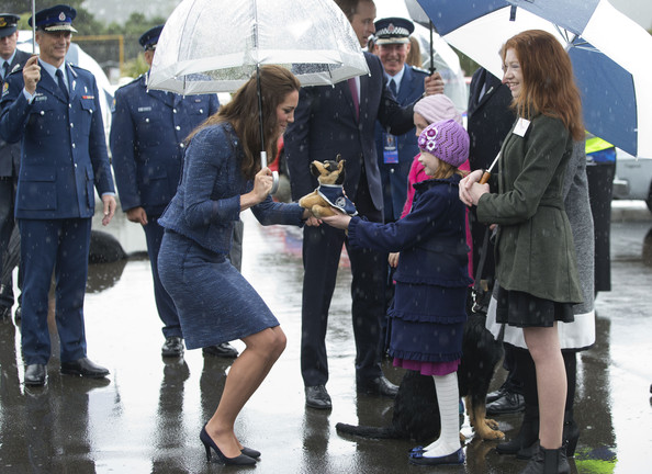 Catherine, Duchess of Cambridge is presented with a toy police dog by Monet Bole, aged eight, during a visit to the Royal New Zealand Police College on April 16, 2014 in Wellington, New Zealand. The Duke and Duchess of Cambridge are on a three-week tour of Australia and New Zealand, the first official trip overseas with their son, Prince George of Cambridge.