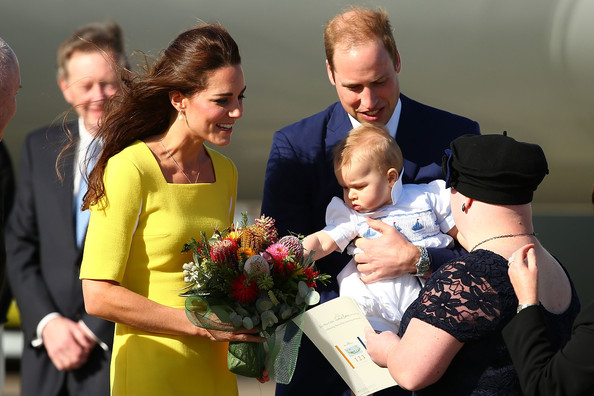 Prince William, Duke of Cambridge, Catherine, Duchess of Cambridge and Prince George of Cambridge meet dignitaries upon arriving at Sydney Airport on RAAF B737 on April 16, 2014 in Sydney, Australia. The Duke and Duchess of Cambridge are on a three-week tour of Australia and New Zealand, the first official trip overseas with their son, Prince George of Cambridge.