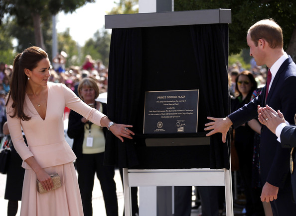 Catherine, Duchess of Cambridge and Prince William, Duke of Cambridge unveil a plaque naming a plaza after their son Prince George outside the Playford Civic Centre in the Adelaide suburb of Elizabeth on April 23, 2014 in Adelaide, Australia. The Duke and Duchess of Cambridge are on a three-week tour of Australia and New Zealand, the first official trip overseas with their son, Prince George of Cambridge.