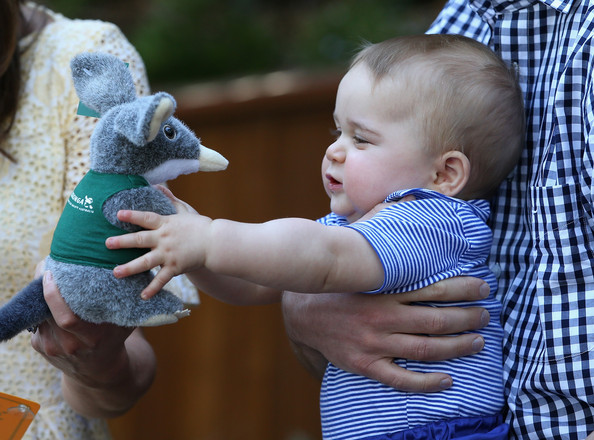 Prince George of Cambridge holds a toy Bilby during a visit to Taronga Zoo on April 20, 2014 in Sydney, Australia. The Duke and Duchess of Cambridge are on a three-week tour of Australia and New Zealand, the first official trip overseas with their son, Prince George of Cambridge.