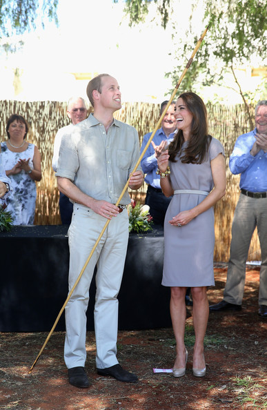 Prince William Duke of Cambridge and Catherine, Duchess of Cambridge are presented with a spear during a visit to an indigenous Training AcademyApril 22, 2014 in Ayers Rock, Australia. The Duke and Duchess of Cambridge are on a three-week tour of Australia and New Zealand, the first official trip overseas with their son, Prince George of Cambridge.