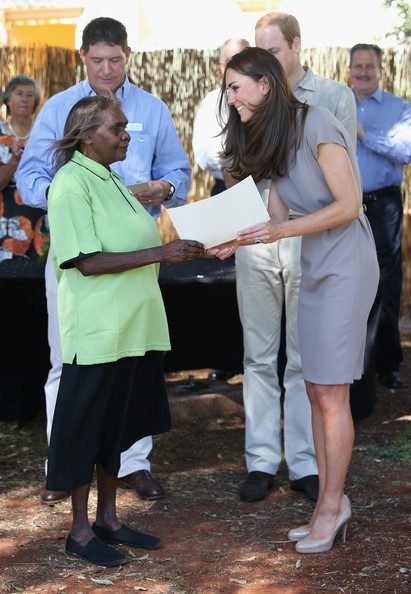 Catherine, Duchess of Cambridge presents certificates as she visits an indigenous Training Academy on April 22, 2014 in Ayers Rock, Australia. The Duke and Duchess of Cambridge are on a three-week tour of Australia and New Zealand, the first official trip overseas with their son, Prince George of Cambridge.