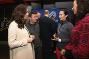 Catherine, Duchess of Cambridge (L) meets singer Laura Wright (2nd R) during her visit to SportsAid to undertake engagements celebrating the Commonwealth at the Copperbox Arena on March 22, 2018 in London, England.
