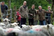 Prince William, Duke of Cambridge and Catherine, Duchess of Cambridge with Chris Brown at Deepdale Hall Farm, a traditional fell sheep farm, in Patterdale during a visit to Cumbria on June 11, 2019 in Patterdale, England. The royal couple are joining a celebration to recognise the contribution of individuals and local organisations in supporting communities and families across Cumbria.