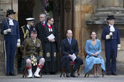 Prince William, Duke of Cambridge and Catherine, Duchess of Cambridge sit with Lieutenant Colonel Craig Stewart (left), during a Beating of the Retreat at the Palace of Holyroodhouse on May 27, 2021 in Edinburgh, Scotland.