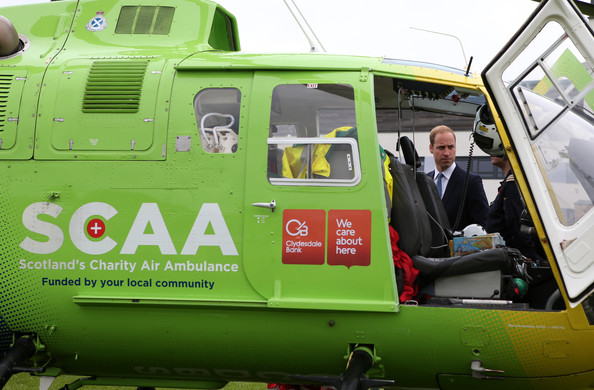 Prince William, Duke of Cambridge talks to Air Ambulance staff during a visit to Strathearn Community Campus on May 29, 2014 in Crieff, Scotland. The Duke and Duchess of Cambridge will spend the day in Scotland where they will tour a distillery and visit a village fete.