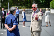 Prince Charles, The Duke of Cornwall chats with care workers as he visits St Austell Healthcare, the Wheal Northey Centre, to recognise and thank staff for their efforts during Covid-19 pandemic on July 21, 2020 in St Austell, England.