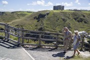Prince Charles, Prince of Wales and Camilla, Duchess of Cornwall walk to the lookout point on Tintagel Castle island during their visit to Cornwall, south west England on July 20, 2020 in Tintagel, England.