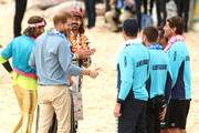 Prince Harry, Duke of Sussex and Meghan, Duchess of Sussex meet Grant Trebilco and Sam Schumacher, founder and co-founder of OneWave, a local surfing community group raising awareness for mental health and wellbeing and Bondi Lifeguards at Bondi Beach on October 19, 2018 in Sydney, Australia. The Duke and Duchess of Sussex are on their official 16-day Autumn tour visiting cities in Australia, Fiji, Tonga and New Zealand.