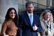 Prince Harry, Duke of Sussex and Meghan, Duchess of Sussex stand with the High Commissioner for Canada in the United Kingdom, Janice Charette (R) as they leave after their visit to Canada House in thanks for the warm Canadian hospitality and support they received during their recent stay in Canada, on January 7, 2020 in London, England.