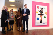 Prince Harry, Duke of Sussex and Meghan, Duchess of Sussex stand with High Commissioner for Canada in the United Kingdom, Janice Charette (C) as they view a special exhibition of art by Indigenous Canadian artist, Skawennati, in the Canada Gallery during their visit to Canada House in thanks for the warm Canadian hospitality and support they received during their recent stay in Canada, on January 7, 2020 in London, England.