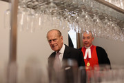 The Very Reverend Dr John Hall (R), the 38th Dean of Westminster Abbey, accompanies Prince Philip, Duke of Edinburgh as he officially opens the new Cellarium cafe at Westminster Abbey on October 17, 2012 in London, England. During his visit to the Abbey the Duke of Edinburgh received a tour of the new Cellarium cafe, the shop and kitchens, meeting staff, college members and leading donors to Westminster Abbey.