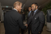 Prince Harry, Duke of Sussex meets England rugby union players Billy Vunipola and Nathan Hughes during a reception in aid of England Rugby's 'Try for Change' programme and the Jonny Wilkinson Foundation at Kensington Palace on February 13, 2019 in London, England.