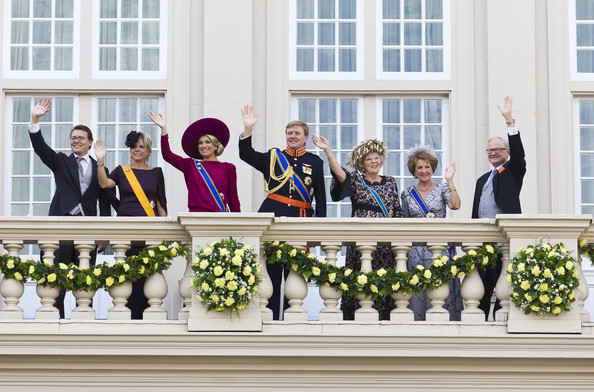 Prince Constantijn, Princess Laurentien, Princess Maxima, Crown Prince Willem Alexander, Queen Beatrix, Princess Margriet and Pieter van Vollenhove of The Netherlands wave from the Noordeinde Palace balcony after attending Budget Day announcement on September 18, 2012 in The Hague, Netherlands.